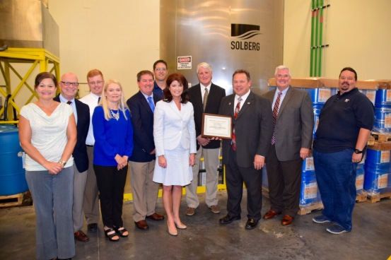 Lt. Governor Kleefisch (center left), Steve Hansen/General Manager (center), and Brian Satula/Administrator WEM (center right) with Solberg team members.