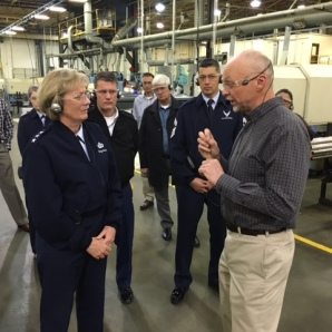 Lt. General Wendy Masiello and Amerex Vice President Vic Modic stop to talk during the tour of the Amerex facility.